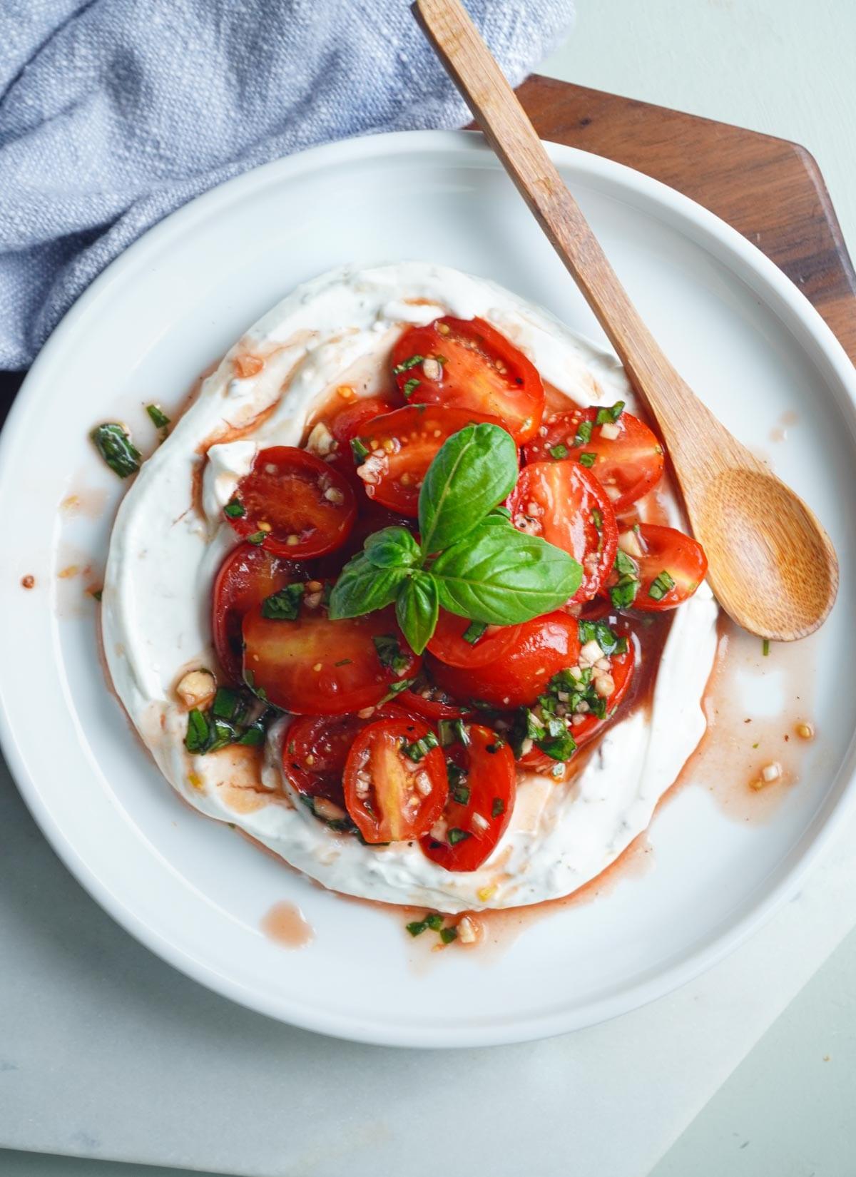 marinated tomatoes over greek yogurt posh plate