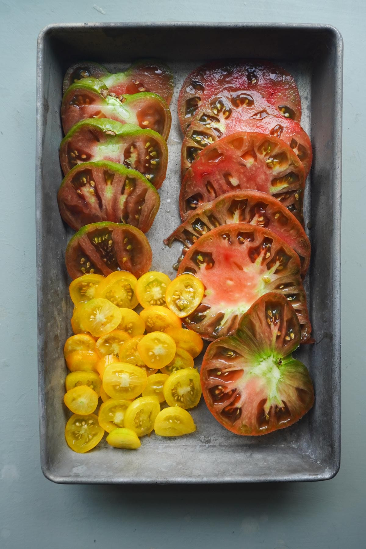 heirloom tomatoes in a baking dish