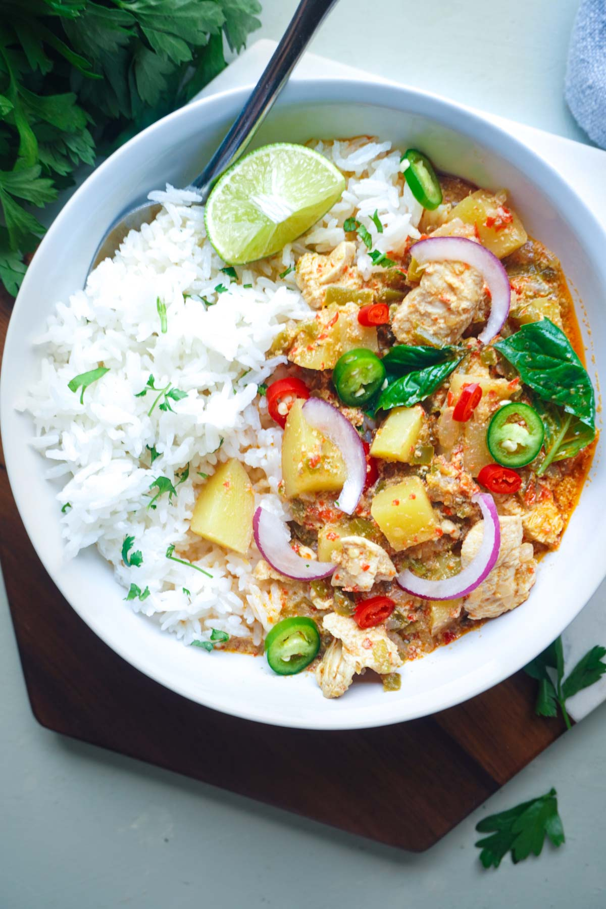 thai curry in a bowl with rice