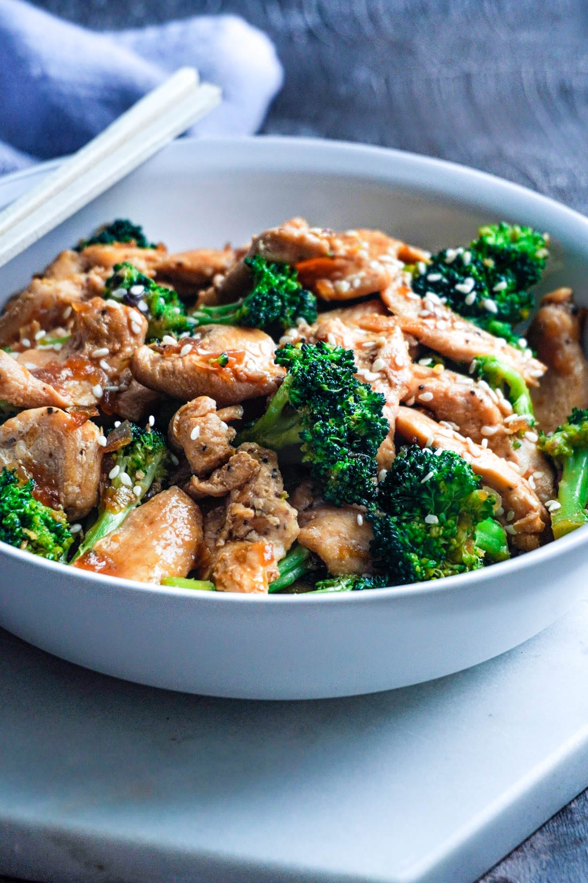 a bowl of Chinese chicken and broccoli
