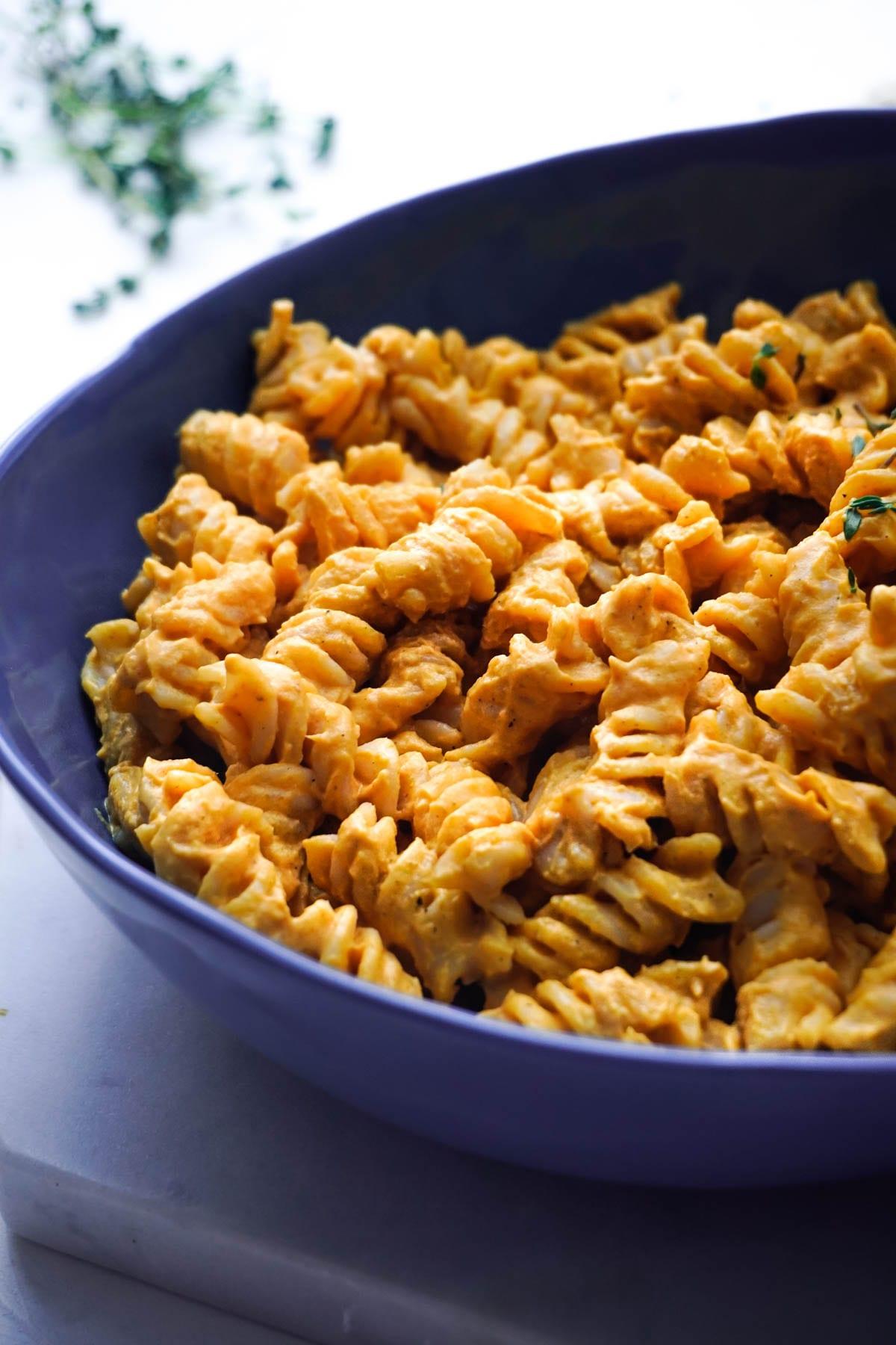 a big bowl of pasta with pumpkin sauce