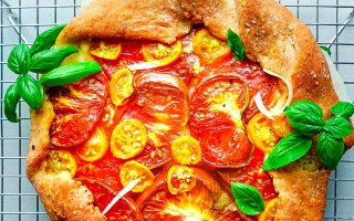 An overhead picture of the finished Tomato Galette on a wire rack.